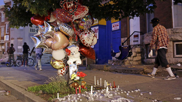 The homicide rate in Baltimore is now at its highest rate, surpassing the 1993 level. Here, balloons and candles mark the spot in the city where a man was shot in July.
