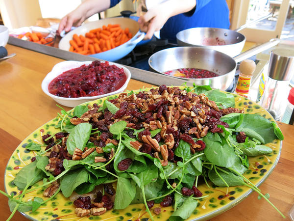 Citrus salad with watercress, dried cranberries, pecans, orange and grapefruit
