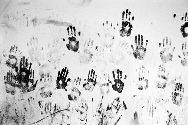 Handprints of children from the stateless Galjeel community in southeastern Kenya decorate a wall of an abandoned school.