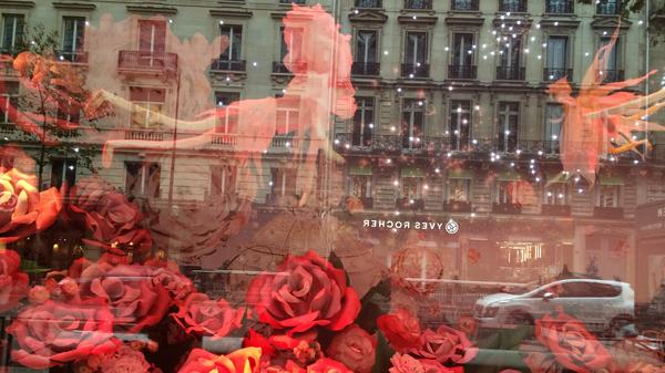 A Christmas display in a window on Paris' Boulevard Haussmann hints at the shopping season — but those who enter the stores are facing security checks.