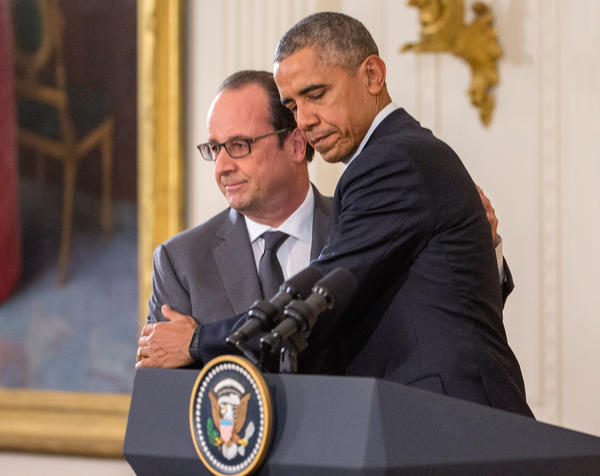 President Obama and French President François Hollande embrace during a joint news conference in the East Room of the White House on Tuesday.