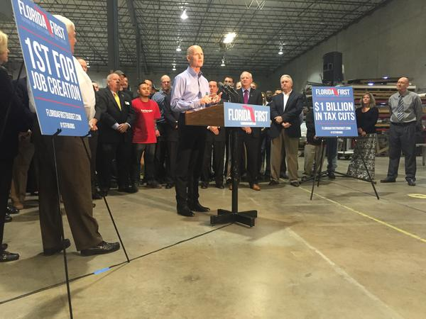 Florida Governor Rick Scott is using hospital cost cutting and a revised funding model to deal with a $400 million loss in indigent health care funding. He unveiled the plan during a stop in Jacksonville announcing his proposed $79.4 billion budget.