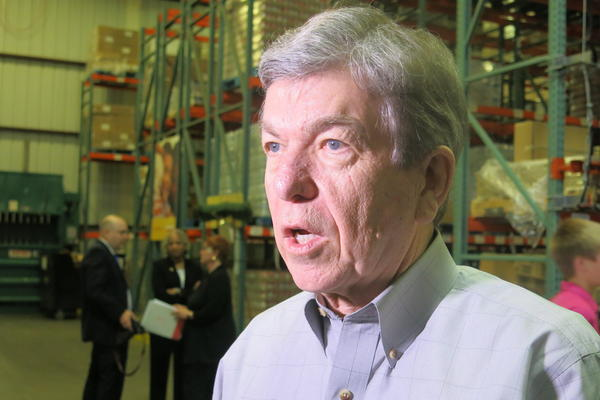 U.S. Sen. Roy Blunt discusses the Syrian refugee crisis during a stop at Harvesters, the community food bank.