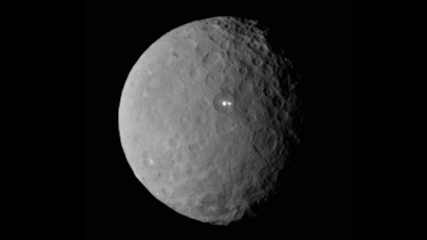 An image of Ceres taken by NASA's Dawn spacecraft shows the two mysterious, bright spots on the dwarf planet.
