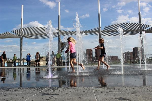 Children play in the fountains at Smale Riverfront Park.