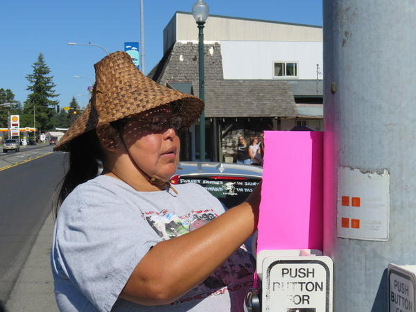 Quileute tribal member Ann Penn-Charles taped up posters to attract Twilight fans to a traditional salmon bake.