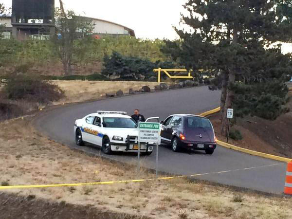 Law enforcement officers are posted at each of the entrances to the Umpqua Community College campus and checking ID.