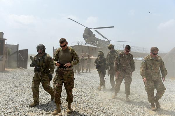 U.S. soldiers in Afghanistan walk away from a helicopter at Forward Operating Base Connelly in the eastern province of Nangarhar on Aug. 13. The U.S. formally ended combat operations in Afghanistan at the end of last year. But nearly 10,000 American troops remain in the country and the U.S. frequently carries out air sorties. Fourteen American military personnel have died in Afghanistan this year.