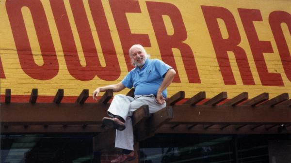 On top of the world: Tower Records founder Russ Solomon above his Sacramento, Calif., store in 1989.