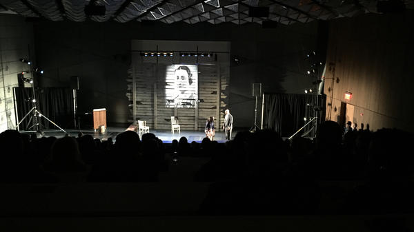 "Costumed actors perform in a dark lecture hall at the New York City Police Academy. The one-act play --€"" which tells the stories of Emmett Till and Anne Frank — is a new training tool the NYPD is using for recruits."