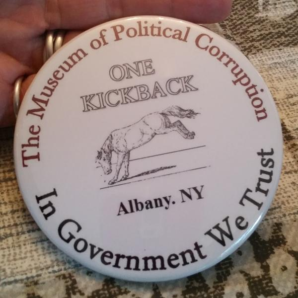 "Every member of the board for the Museum of Political Corruption received this ""kickback"" button in their information folders at a recent meeting."