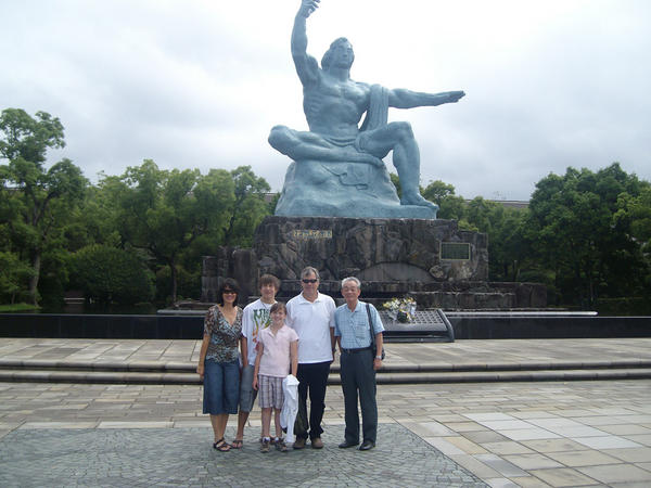 The family during a visit to the Peace Statue at the Nagasaki ground zero memorial park with Tuyoshi Ozaki.