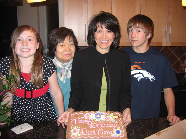 Sarah McCormick, left, Kazuko [Ozaki] Nishimoto, Shirley Olinger and Sean McCormick celebrate Nishimoto's birthday in 2004.