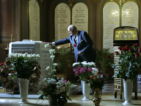 Dmitry Romanov, a descendant of the czar's family, pays his respects in 2008 at the tomb holding the remains of Nicholas II, his wife and three of their daughters in St. Petersburg's St. Peter and Paul Cathedral.