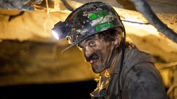 Coal miner Dennis Ferrell watches over conveyer belts carrying coal out of a mine in Welch, W.Va. Climate talks in Paris are focused on moving away from coal in hopes of protecting the environment.
