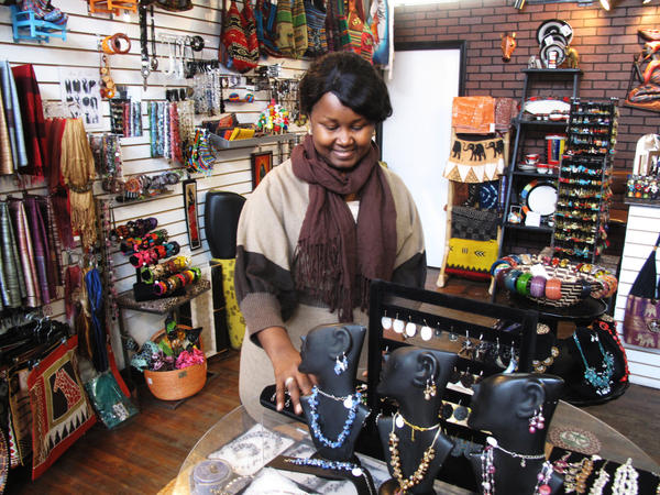 "Louise Sano sells jewelry, clothing and gifts at her boutique, Global Villages, on Buffalo's west side. ""It's very easy to integrate as a new American, a new person coming to the U.S. So I feel like I have created my own village,"" she says."