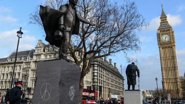 Peace symbols were drawn on the sculpture of former British Prime Minister David Lloyd George in Parliament Square ahead of Wednesday's debate in the House of Commons on whether the U.K. should become involved in airstrikes on ISIS targets in Syria.