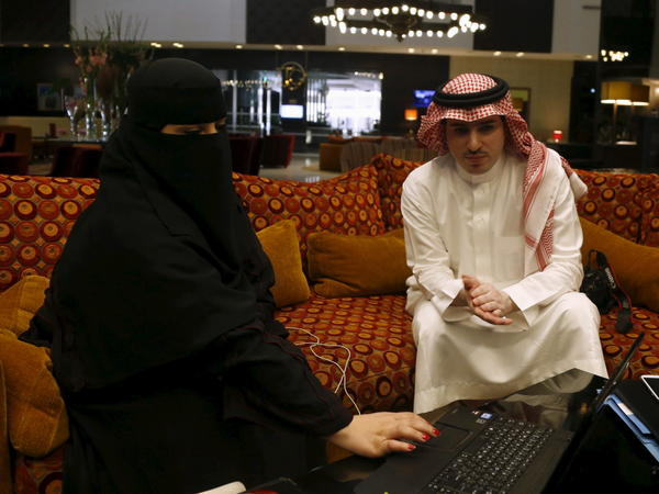 Fawzia al-Harbi, a candidate in Saudi local municipal council elections, was accompanied by a male chaperone during a campaign visit to a Riyadh shopping mall on Sunday. Saudi women are running for election and will be able to vote for the first time on Dec. 12.