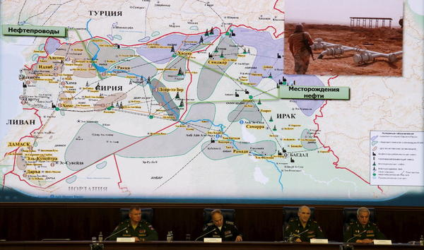 Russian Defence Ministry officials sit under a display showing the Turkish-Syrian border during a news conference Wednesday in Moscow.