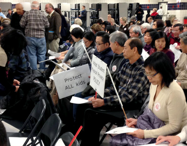 Parents pack the high school cafeteria in anticipation of the District 211 school board decision yesterday. Many were angered by the agreement, but supporters were also in attendance.