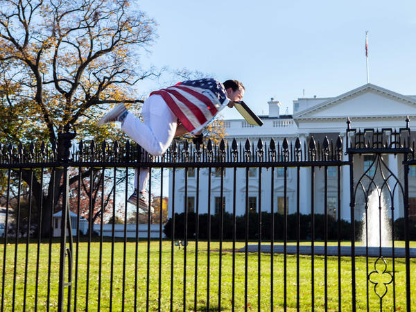 Joseph Caputo scales a fence at the White House, triggering a lockdown on Thanksgiving Day. He was immediately apprehended by Secret Service and taken into custody.