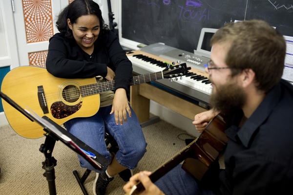 Tanzania Cantrell, 13, of Saginaw, Mich., jokes with her guitar instructor, Ryan Fitzgerald, during a lesson at Major Chords for Minors.