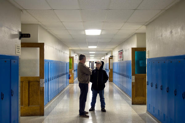 John Vowell (left) talks with Tyler Ryals, 12, of Saginaw, Mich., about school and friends after Ryals' guitar lesson. Major Chords for Minors moved into the old Fuerbringer Elementary School, which is now run by the REACH Community Church.