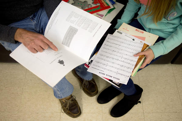 Major Chords for Minors instructor Bruce Leaman (left) and Paige Rosas, 12, look through music books to find some songs for Rosas to practice with during her piano lesson.
