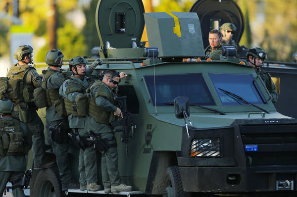 Police officers conduct a manhunt after a mass shooting in San Bernardino, Calif., on Dec. 2, 2015.