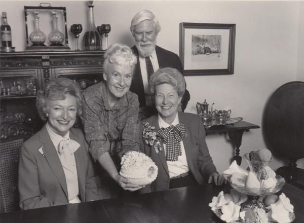 "Phila Hach (standing, center) and her husband, Adolf Hach, are seen here with Minnie Pearl (right) of Grand Ole Opry fame, and an unidentified woman. ""What the Grand Ole Opry did for country music, she has done for Southern food,"" one food writer wrote about Hach."