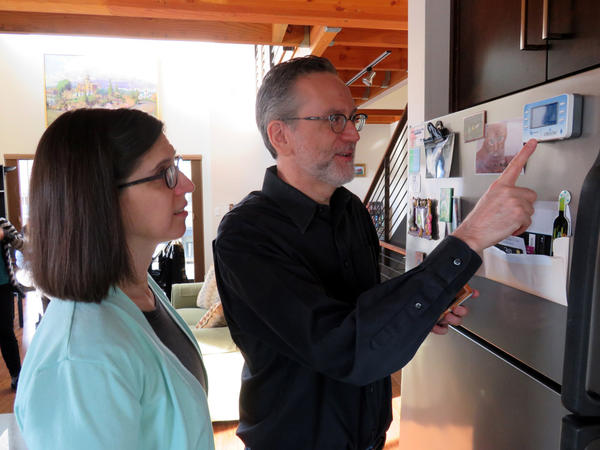 Living in a ''net zero energy'' home has made Bryan Bell and Karin Weekly more conscious of their energy and water usage, which they monitor on small, wireless displays.