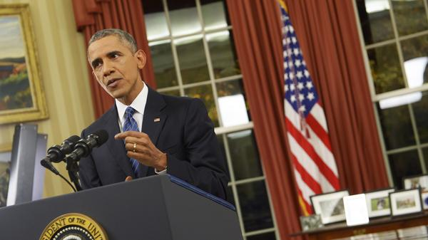 President Obama speaks during an address to the nation from the Oval Office of the White House.