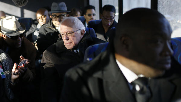 Bernie Sanders with preachers and reporters on a bus in Baltimore on Tuesday.