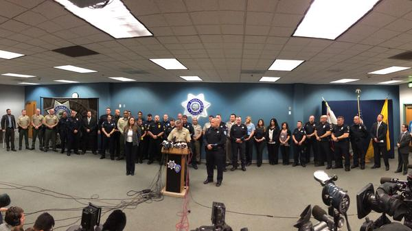 Sheriff John McMahon introduces first responders at a news conference.