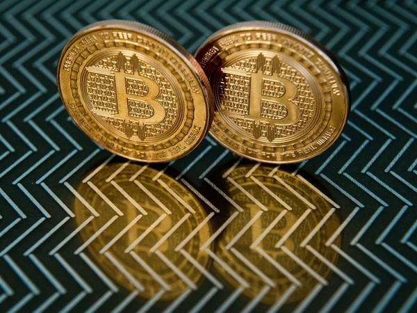 Bitcoin medals represent the digital currency whose creator's identity has remained a mystery.