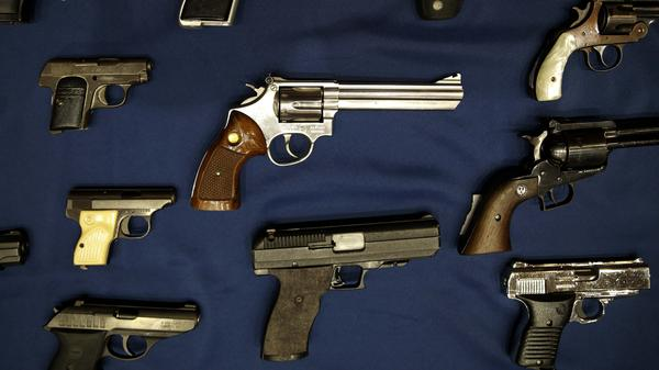 Guns seized by the police are displayed during an Oct. 2015 news conference in New York.
