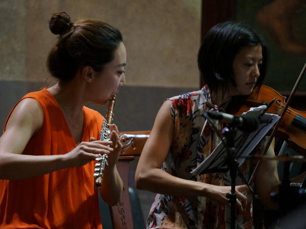 Flutist Sooyun Kim and violinist Karen Kim perform at their Havana concert in November 2015.