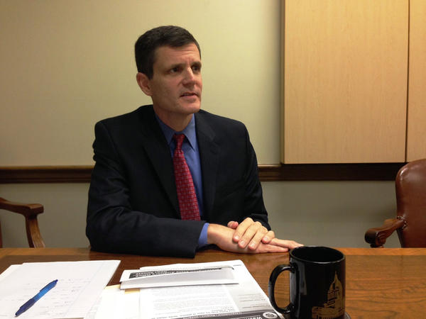 Indicted Washington State Auditor Troy Kelley abruptly returned to office Tuesday, ending a seven month leave of absence pending his federal trial.