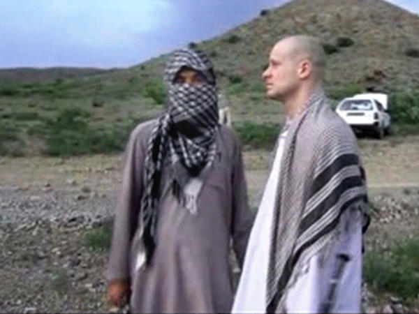 A video frame grab of Army Sgt. Bowe Bergdahl released by the Voice of Jihad website shows the soldier during his captivity. Bergdahl is the subject of the second season of <em>Serial.</em>