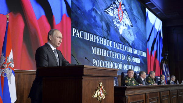 Russian President Vladimir Putin addresses the audience Friday during an annual meeting at the Defense Ministry in Moscow.