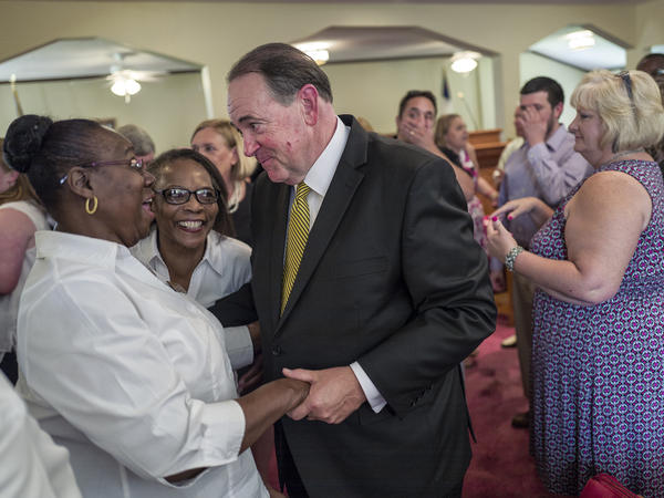 GOP presidential candidate and former Arkansas Governor Mike Huckabee courts the religious vote at the Rock Hill Missionary Baptist Church in Manning, South Carolina.