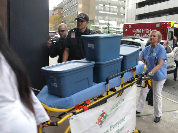 Supporters of single-payer health care delivered signatures supporting their ballot measure on a stretcher to Colorado's secretary of state.