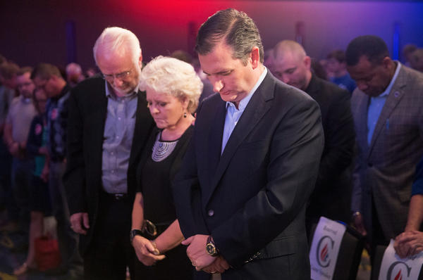 "Republican presidential candidate Sen. Ted Cruz prays before the start of his Religious Liberty Rally in Des Moines, Iowa, in August. He is among the Republican candidates who say there is a ""war on faith"" in America."