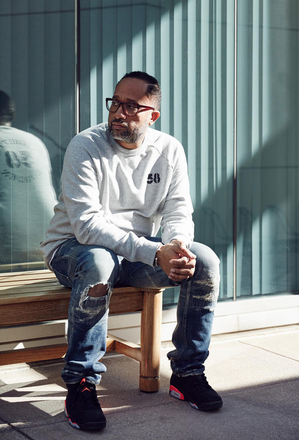 Kenya Barris, the creator and writer of <em>Black-ish</em>, sits outside his office on the ABC lot in Burbank, Calif., in December.