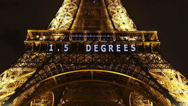 "One target for limiting global warming — ""1.5 DEGREES"" — is projected on the Eiffel Tower on Friday as part of the United Nations Climate Change Conference in Paris."