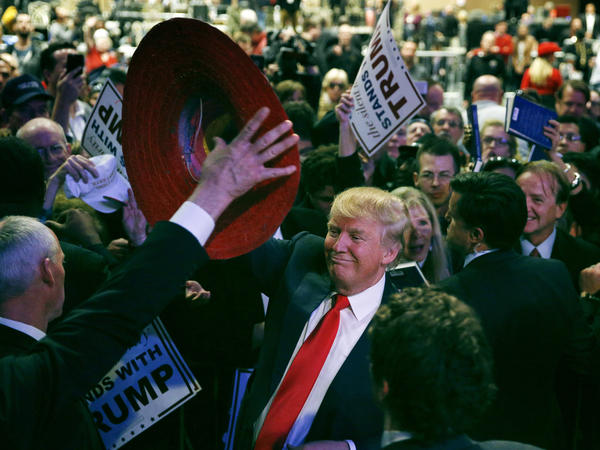 Donald Trump is given a sombrero at a raucous rally of thousands in Las Vegas.