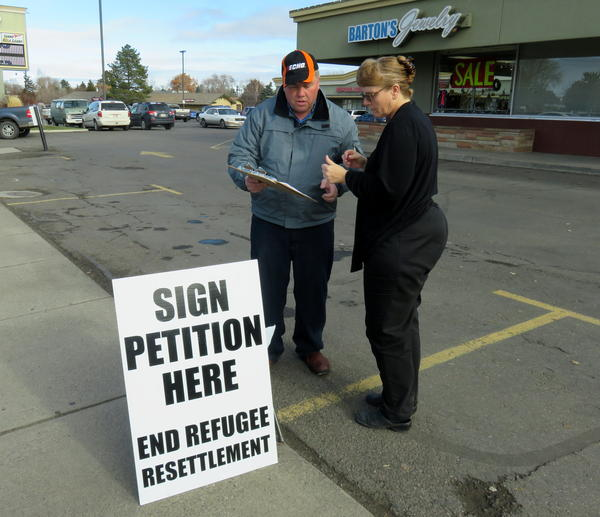 Buhl, Idaho resident Marie Christopherson stopped to sign Rick Martin's petition to ban refugee centers in Twin Falls County.