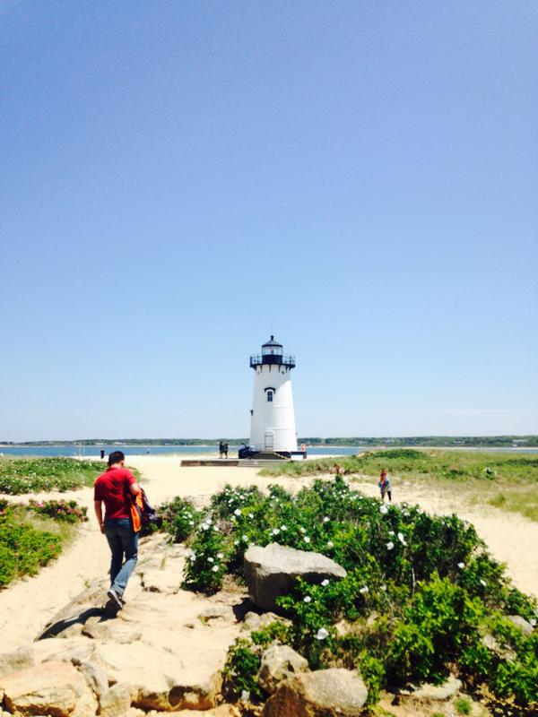 Chinese tour guide Mo Leung visits the Edgartown lighthouse on the Massachusetts island of Martha's Vineyard. (Peter O'Dowd)