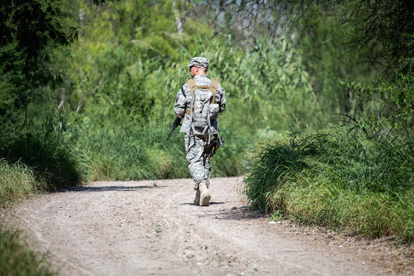 A soldier from the Texas Army National Guard observes an area near the Rio Grande River.