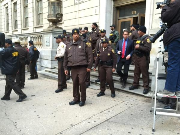 Sheriff's deputies gather outside the Courthouse East after the William Porter trial ended in a hung jury.